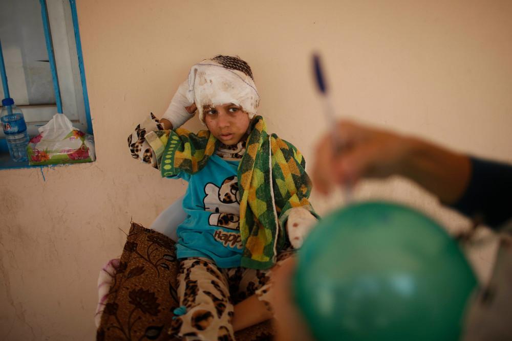Douha, 8 ans, orpheline. © Suhaib Salem/Reuters
